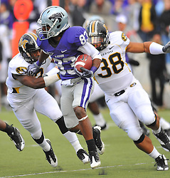 Nov 14, 2009; Manhattan, KS, USA; Kansas State running back John Hubert (33) runs for yardage as Missouri defensive lineman Chris Earnhardt (38) attempts the taclkle in the second half at Bill Snyder Family Stadium. The Tigers won 38-12. Mandatory Credit: Denny Medley-US PRESSWIRE