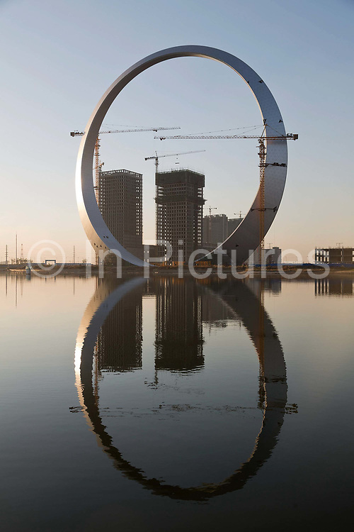 A view of a giant decorative arch being erected in front of a residential development in Fushun, Liaonin Province, China on 08 October 2012.  While the Chinese government has tried various ways to cool down the property market, real estate prices have still seen a steady increase in recent years, proving hard for the country to move away from an investment driven economy.