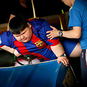 Dzhambulat Khotokhov, 6, one of the fattest boys in the world, is helped by his 14-year-old brother into a vehicle in Nal'chik, in southern Russia. Now 1.4 metres tall and weighing about 100 kg, Khotokhov has grabbed world attention as the biggest kid in the world since he was three. .Khotokhov lives with his mother Neyla and his brother, 14-year-old Mukha. .