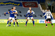 Cardiff City's Kieffer Moore (10) under pressure from Barnsley FC's  Michael Helik (30) during the EFL Sky Bet Championship match between Cardiff City and Barnsley at the Cardiff City Stadium, Cardiff, Wales on 3 November 2020.