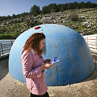 Hila prays for a husband at the grave of Yonatan ben Uziel at Amukah in the Galilee in Israel. Over the centuries the tradition developed that those seeking for their soul-mates would be married within one year if they prayed at Rabbi Ben-Uziel's tomb.
