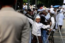 May 5, 2017 - Jakarta, Indonesia - Muslims in Jakarta take action in front of the Supreme Court building in Jakarta, which demands the Supreme Court to supervise the judge who leads the trial of a blasphemy case perpetrated by Basuki Tjahja Purnama (Ahok) to be fair and not intervened by anyone in making decisions (Credit Image: © Denny Pohan via ZUMA Wire)