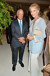 HRH PRINCESS MICHAEL OF KENT and MICHEL DE CARVALHO at a dinner hosted by Cartier in celebration of The Chelsea Flower Show held at The Hurlingham Club, London on 19th May 2014.