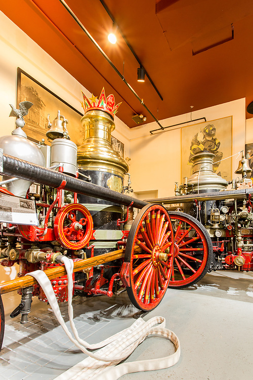 """On the left, a horse-drawn steam fire engine made by the La Fance company, Elmira, New York, in 1901. In the background on the right is a """"Metropolitan"""" fire engine, patented 1898, by American a France."""