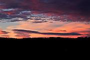 dark orange wind swept clouds at sunrise