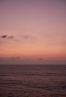 Pastel colored sky and clouds over the Pacific Ocean at dawn.  Image 7 of 21  for a panorama taken with a Fuji X-T1 camera and 35 mm f/1.4 lens  (ISO 400, 35 mm, f/2.8, 1/30 sec). Raw images processed with Capture One Pro and stitched together with AutoPano Giga Pro.