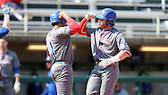CARY, NC - MARCH 04: UMass Lowell's Steve Passatempo (right) celebrates his home run with Oscar Marchena (1). The University of Massachusetts Lowell River Hawks played the University of Notre Dame Fighting Irish on March 4, 2017, at USA Baseball NTC Stadium Field in Cary, NC in a Division I College Baseball game, and part of the Irish Classic tournament. UMass Lowell won the game 8-0.