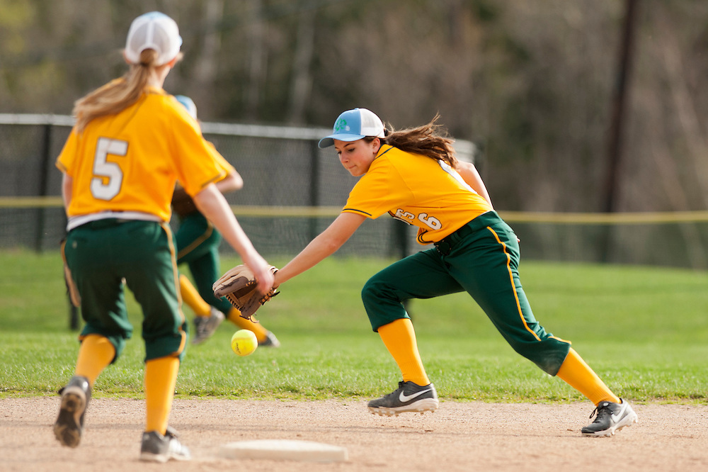 BFA's Breanna Dupuis fields the ground ball during the girls softball game between BFA-St. Albans and Mount Mansfield at MMU High School on Thursday afternoon May 8, 2014 in Jericho, Vermont. (BRIAN JENKINS, for the Free Press)