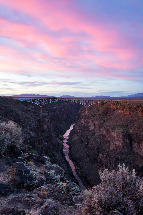 Sunset and sage cradle the Rio Grande, West Rim Trail at the Gorge Bridge, Taos County, New Mexico