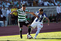 May 25, 2019 - Oeiras, Portugal - OEIRAS, PORTUGAL - MAY 25: Porto's Mexican midfielder Hector Herrera (R ) vies with Sporting's midfielder Nemanja Gudelj from Serbia (L) during the Portugal Cup Final football match Sporting CP vs FC Porto at Jamor stadium, on May 25, 2019, in Oeiras, outskirts of Lisbon, Portugal. (Credit Image: © Pedro Fiuza/NurPhoto via ZUMA Press)