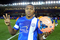 Peterborough United's Britt Assombalonga with the match ball at full-time after scoring a hat-trick - Photo mandatory by-line: Joe Dent/JMP - Tel: Mobile: 07966 386802 07/12/2013 - SPORT - Football - Peterborough - London Road Stadium - Peterborough v Tranmere - FA Cup - Second Round