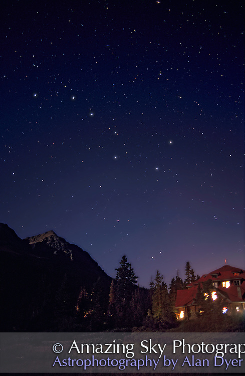 Big Dipper over Num-Ti-Jah lodge at Bow Lake, Banff National Park, Alberta. Camera-on-tripod exposure with 28mm lens at f/2.8 and Ektachrome 400 slide film, for 40 seconds. In full moonlight.