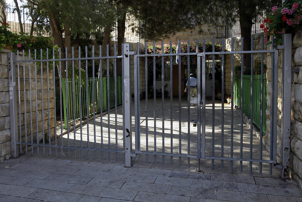 A closed and locked entrance gate to a school in the Jerusalem neighborhood of Gilo, during a general teachers strike, on September 3, 2009.