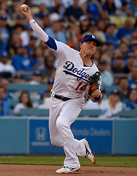 June 24, 2017 - Los Angeles, California, U.S. - Los Angeles Dodgers shortstop Enrique Hernandez throws late as Colorado Rockies' Nolan Arenado (not pictured) is safe at first base in the first inning of a Major League baseball game at Dodger Stadium on Saturday, June 24, 2017 in Los Angeles. Los Angeles. (Photo by Keith Birmingham, Pasadena Star-News/SCNG) (Credit Image: © San Gabriel Valley Tribune via ZUMA Wire)