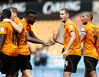 Football - The Championship- Wolverhampton Wanderers v Leicester City -  Wolves' Tongo Doumbia tries to calm an argument between Roger Johnson and Bakary Sako at Molineux