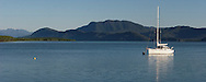 Yacht moored at Lucinda Cove Queensland Australia with Hinchinbrook Island in the background