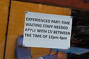 A sign in a restaurant window advertises a vacancy for experienced part-time waiting staff as British employers face the worst labour shortage since the late 90s on 28th June, 2021 in Leeds, United Kingdom. Data from recruitment firms across the UK has shown that Brexit and the Covid pandemic have led to severe staff shortages in the country, with sectors like hospitality and catering being some of the worst hit.
