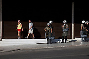 Riot police presence and some disconcerted tourists as students and teachers demonstrate against austerity measures and planned education reforms in Athens. The demonstration is against an education reform bill which aims to improve the operation of universities.