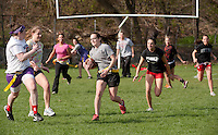 Senior Kelsey Stone makes her way through a sea of underclassmen for some yardage during Friday afternoons Powder Puff Football game at Laconia High School.  (Karen Bobotas/for the Laconia Daily Sun)Powder Puff football at Laconia High School May 6, 2011.