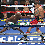 LAS VEGAS, NV - SEPTEMBER 13: Floyd Mayweather Jr. (L) throws a jab at Marcos Maidana during their WBC/WBA welterweight title fight at the MGM Grand Garden Arena on September 13, 2014 in Las Vegas, Nevada. (Photo by Alex Menendez/Getty Images) *** Local Caption *** Floyd Mayweather Jr; Marcos Maidana