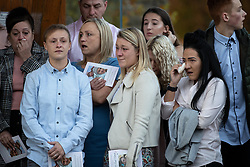 © Licensed to London News Pictures . 30/10/2018. Accrington , UK . Mourners outside the crematorium after the service . The funeral of Gemma Nuttall at Accrington Crematorium . Gemma died of cancer despite initially seeing off the disease after radical immunotherapy treatment in Germany , paid for with the fundraising support of actress Kate Winslet , who read of Gemma's plight on a crowdfunding website shortly after she lost her own mother to cancer . Permission to photograph given by Gemma's mother , Helen Sproates . Photo credit : Joel Goodman/LNP
