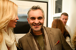 Interior designer MARTYN LAWRENCE BULLARD at a private view of Photographs by Julian Lennon held at The Little Black Gallery, 13A Park Walk, London SW10 on 17th September 2013.
