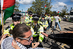 London, UK. 2 September, 2019. Police officers block activists trying to prevent a delivery to the Excel Centre on the first day of week-long protests against DSEI 2019, the world's largest arms fair. The first day of creative action was hosted by activists calling for a ban on arms exports to Israel and featured workshops, speakers, street theatre and dance. Israeli arms companies display weapons at DSEI marketed as 'combat-proven' following deployment against Palestinian communities.
