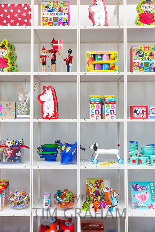 Bright colored children's toys souvenirs and Moomin by Tove Jansson, characters in shop, Arken Museum of Modern Art Denmark