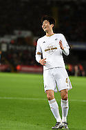 Ki Sung-Yueng of Swansea city reacts after he sees his shot at goal saved.Barclays Premier league match, Swansea city v West Ham Utd at the Liberty Stadium in Swansea, South Wales  on Sunday 20th December 2015.<br /> pic by  Andrew Orchard, Andrew Orchard sports photography.