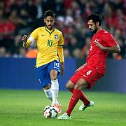 Turkey's Bekir Irtegun (R) and Brazil's Neymar JR (L) during their a international friendly soccer match Turkey betwen Brazil at Sukru Saracoglu Arena in istanbul November 12, 2014. Photo by Aykut AKICI/TURKPIX