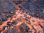 Acid mine drainage from abandoned gold mining shaft, Kantishna Mining District, Denali National Park, Alaska.