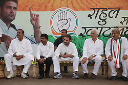 September 16, 2016 - Kaushambi, India - Indian Congress party's vice president and leader Rahul Gandhi and other paty leaders sit on cots during a public meeting, popularly known as Khaat Panchayats, where organizers make arrangement of thousands of Khaats (cots) for the people attending the meetings to sit on them, while listening to their leader, in tenwa village , in Kaushambi on September 15, 2016.Khaat (rustic Hindi word for cot) is symbol of villages in general and of farmers in particular. By naming the public meetings as Khaat Panchayats arranging khaats during the meetings, a strategy has been drawn to connect Rahul and Congress with the farmers of Uttar Pradesh and thus reap the electoral harvests during the next assambly elections. (Credit Image: © Ritesh Shukla/NurPhoto via ZUMA Press)