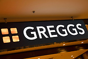 Sign for the food and bakery brand Greggs in Birmingham, United Kingdom.