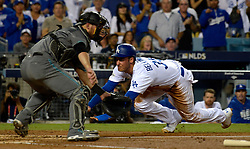October 6, 2017 - Los Angeles, California, U.S. - Los Angeles Dodgers' Cody Bellinger scores past Arizona Diamondbacks catcher Jeff Mathis (2) on a double by teammate Yasiel Puig (not pictured) in the first inning of a National League Divisional Series baseball game at Dodger Stadium on Friday, Oct. 06, 2017 in Los Angeles. (Photo by Keith Birmingham, Pasadena Star-News/SCNG) (Credit Image: © San Gabriel Valley Tribune via ZUMA Wire)