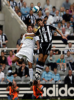 Photo: Jed Wee/Sportsbeat Images.<br /> Newcastle United v Juventus. Pre Season Friendly. 29/07/2007.<br /> <br /> Newcastle's Albert Luque (R) jumps above Juventus' Zdenek Grygera to win the ball.