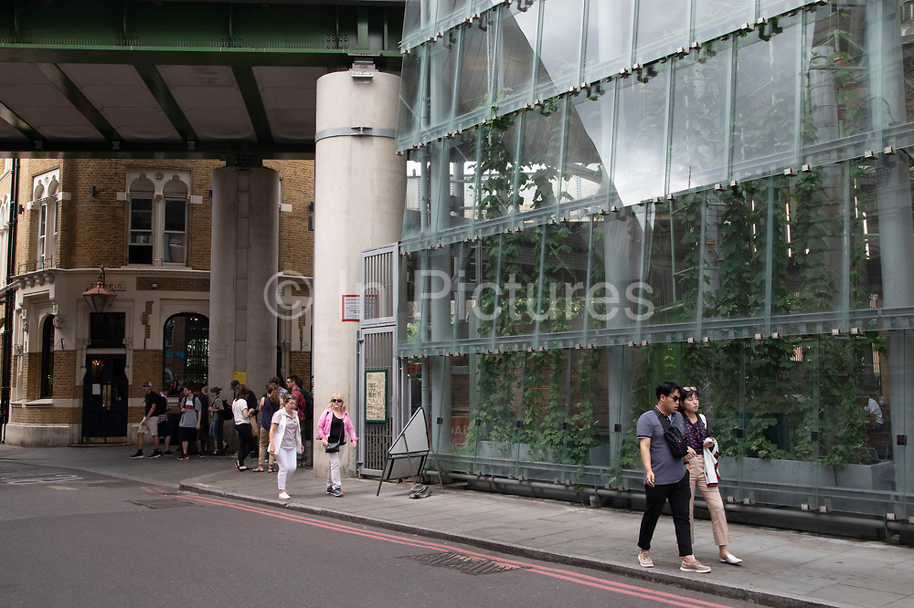 Newly refurbished glass entrance to Borough Market in London, England, United Kingdom. Borough Market is a retail food market and farmers market in Southwark. It is one of the largest and oldest food markets in London, with a market on the site dating back to at least the 12th century. A farmers market is a physical retail marketplace intended to sell foods directly by farmers to consumers. Farmers markets may be indoors or outdoors and typically consist of booths, tables or stands where farmers sell fruits, vegetables, meats, cheeses, and sometimes prepared foods and beverages.