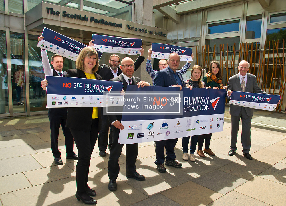 Pictured: Members of the No 3rd Runway Coalition were joined by MSPs, Alison Johnstone (Green Party) MPatrick Harvie (Green Party) Andy Whghtman (Green Party), and Neil Gil Patterson (SNP)<br /> <br /> The No 3rd Runway Coalition was at the Scottish Parliament today to urge the SNP to change their position on supporting the Heathrow third runway proposal and to send the UK Government a message to 'think again'. Campaigners will be joined by MSPs from Scottish Greens, and SNP to highlight the environmental damage to Scotland and the rest of the UK that building a third runway would mean, as well as the fact that Scottish airports would suffer as a result.  Campaigners also believe that the SNP appear to be too trusting of UK Government promises – particularly in relation to the impact on Climate Change commitments - as revealed by Keith Brown, Cabinet Secretary for Economy, Jobs and Fair Work, in response to a question from Patrick Harvie MSP in the Scottish Parliament last Thursday.<br /> <br /> The Labour party announced their formal opposition to the proposal on Wednesday, on the basis that the UK Government's Airports National Policy Statement failed all four of party's tests on climate change, delivering extra capacity, air pollution and benefits to be felt outside of London. Additionally, the long-awaited UK Government mitigation framework for international aviation emissions won't be published for many months after MPs have been asked to support the Heathrow proposal. A recent report by the New Economics Foundation seriously calls into question the economic case – using the Department for Transport's own measures; and this is before taking into account the economic impact of Brexit <br /> <br /> <br /> <br /> Ger Harley   EEm 21 June 2018