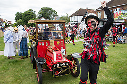 Datchet, UK. 30 June, 2019. Datchet Border Morris, an all male Border Morris side with a mixed band who perform dances in the English border Morris style, dance alongside a 1904 De Dion Bouton, the first pre-1905 vehicle to arrive on the 48-mile Ellis Journey from Micheldever station near Winchester to Datchet. The Ellis Journey is a reenactment of the first recorded journey by a motorised carriage in England undertaken by pioneer automobilist Hon. Evelyn Ellis in his new, custom-built Panhard-Levassor on 5th July 1895.