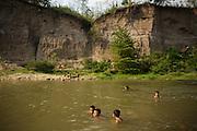 Children swim in a river in San Esteban, Honduras on Thursday April 25, 2013.