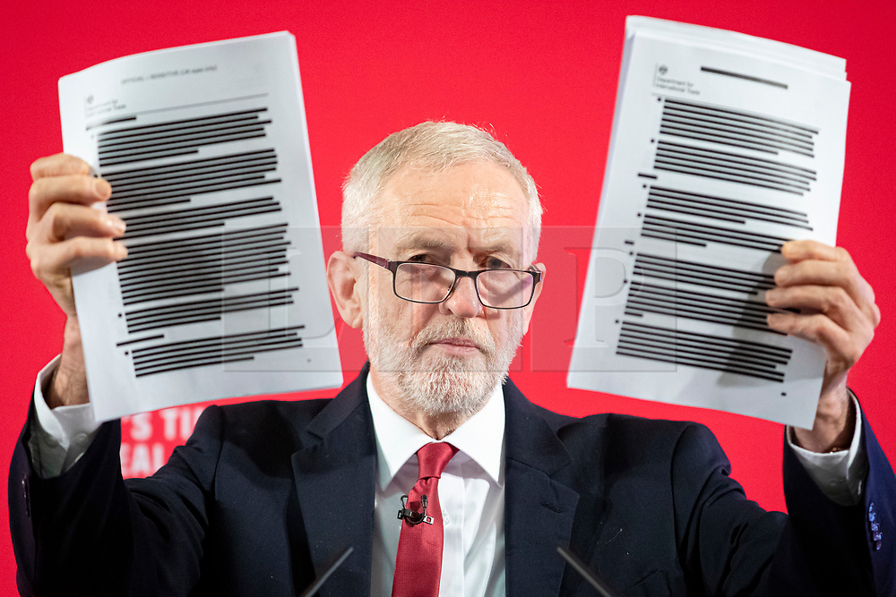 © Licensed to London News Pictures. 27/11/2019. London, UK. Labour Party Leader Jeremy Corbyn holds a copy of an redacted report on trade negotiations with the USA at an event in Westminster. The report allegedly includes the NHS. Photo credit: Rob Pinney/LNP