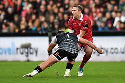 Hadleigh Parkes of Scarlets is tackled by Gareth Thomas of Ospreys<br /> <br /> Photographer Craig Thomas/Replay Images<br /> <br /> Guinness PRO14 Round 11 - Ospreys v Scarlets - Saturday 22nd December 2018 - Liberty Stadium - Swansea<br /> <br /> World Copyright © Replay Images . All rights reserved. info@replayimages.co.uk - http://replayimages.co.uk
