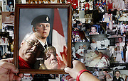 Dorothy and Gaetan Gendron hold a portrait of their son Eric over a collage of pictures of him at their home in Rockland, Ont. on Tuesday, June 6, 2006. Eric was killed on on April 3, 2001., in a motor vehicle accident. He was traveling as a passenger and the driver was drunk.  .(Ottawa Sun Photo By Sean Kilpatrick)
