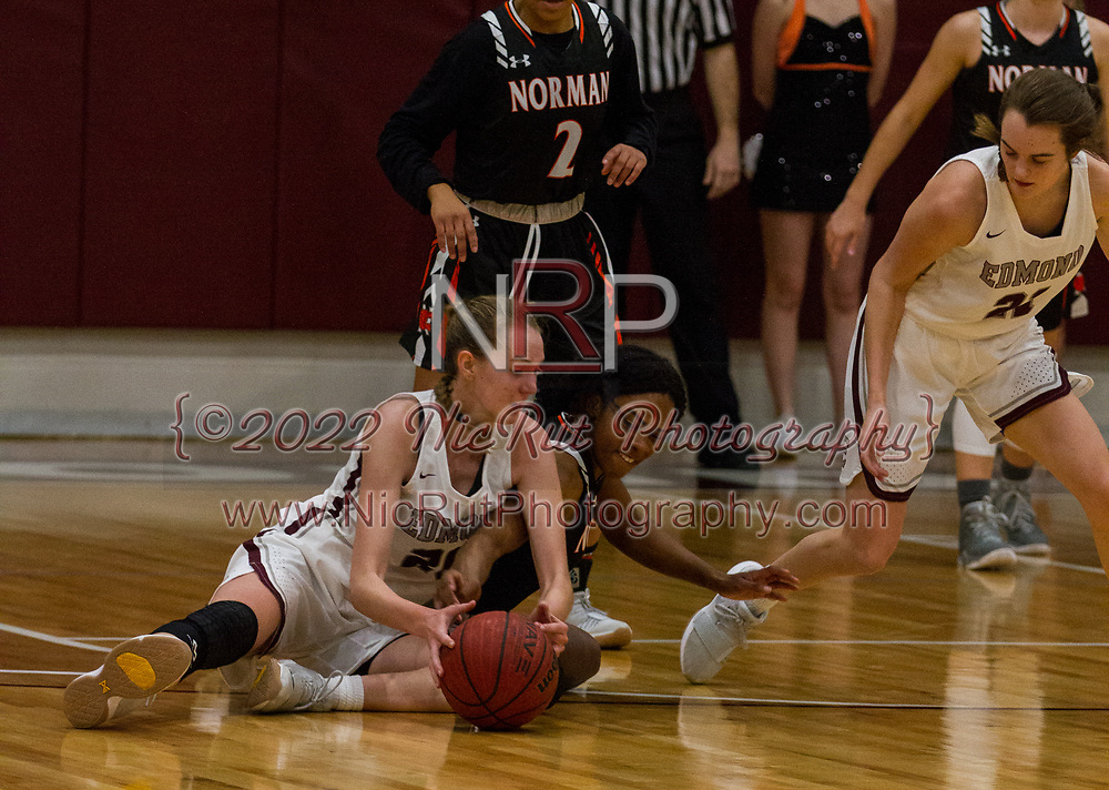 The Lady Tigers and the Lady Bulldogs hit the ground fighting for ball possession late in the first half of the game.