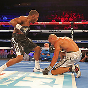 NEW ORLEANS, LA - JULY 14:  Charles Conwell hovers over Travis Scott during the Regis Prograis v Juan Jose Velasco ESPN boxing match at the UNO Lakefront Arena on July 14, 2018 in New Orleans, Louisiana.  (Photo by Alex Menendez/Getty Images) *** Local Caption *** Charles Conwell; Travis Scott