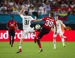 July 31, 2018 - Miami Gardens, Florida, USA - Real Madrid C.F. defender Sergio Lopez (31) and Manchester United F.C. midfielder Scott McTominay (39) fight for the ball during an International Champions Cup match between Real Madrid C.F. and Manchester United F.C. at the Hard Rock Stadium in Miami Gardens, Florida. Manchester United F.C. won the game 2-1. (Credit Image: © Mario Houben via ZUMA Wire)