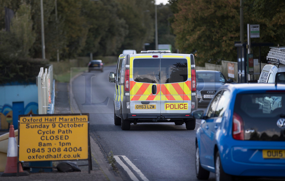 © Licensed to London News Pictures. 30/09/2016. Oxford, UK. A police van drives on the Marston Ferry Road in the Summertown area of Oxford. A police hunt continues in Oxford for two men who abducted and raped a 14-year-old girl while she was on her way to school. The teenager was snatched and driven away from the Summertown area of Oxford at 8.25 on Wednesday morning. Photo credit: Peter Macdiarmid/LNP