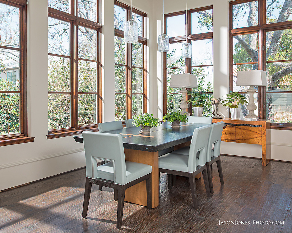 Open concept dining room with natural light and elegant interior decorations