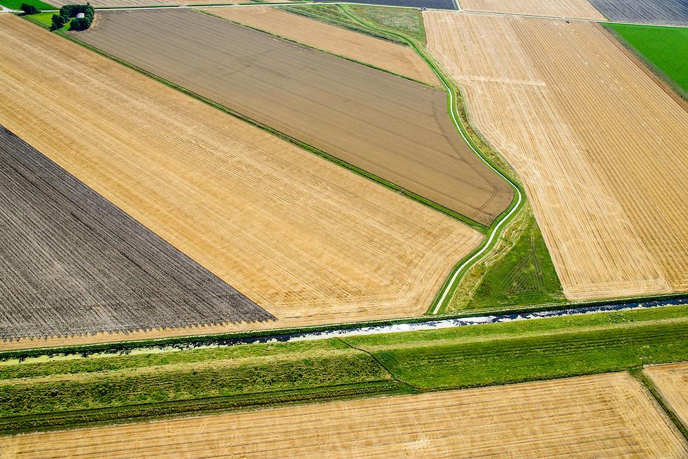 Nederland, Groningen, Oldambt,  05-08-2014; de Reiderwolderpolderdijk tussen de Reiderwolderpolder uit 1870 en de later voltooide de Carel Coenraadpolder uit 1924 (boven). Beide polders zijn ontstaan door landaanwinning, het inpolderen van kwelders van de Dollard.<br /> Reiderwolderpolder dike between the Reiderwolderpolder from 1870 and the later completed the Carel Coenraad polder from 1924 (above). Both polders were created through land reclamation<br /> luchtfoto (toeslag op standard tarieven);<br /> aerial photo (additional fee required);<br /> copyright foto/photo Siebe Swart