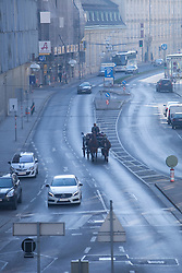 Horse drawn carriage Vienna street traffic cars