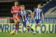 Max Power (Wigan) runs with the ball during the Sky Bet League 1 match between Wigan Athletic and Gillingham at the DW Stadium, Wigan, England on 7 January 2016. Photo by Mark P Doherty.